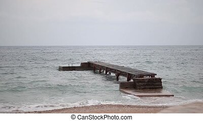 Jetty on the beach in Budva. Near the old town