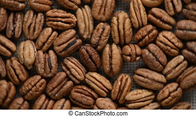 The nut pecan rotates on the turntable. - Nuts pecan turn on...