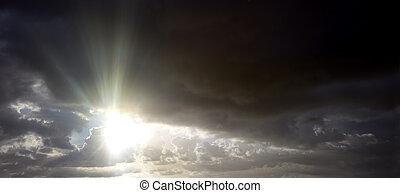 Stunning stormy sky image at sunrise with sun rays -...