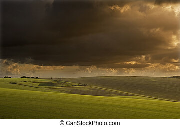 Beautiful stormy landscape over agricultural English contryside