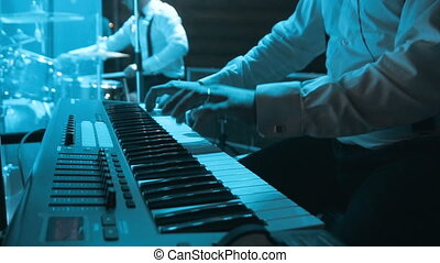 Pianist Playing on Synthesizer - Musician playing on the...