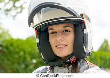 girl with happy face in white helmet with an open visor - A...