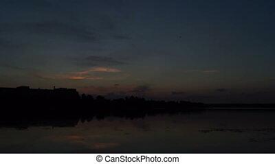 Beautiful lake dawn - Beautiful clouds over a lake at...