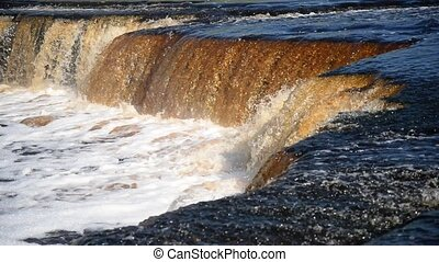 Small waterfall at sunny day. - Small waterfall at sunny...