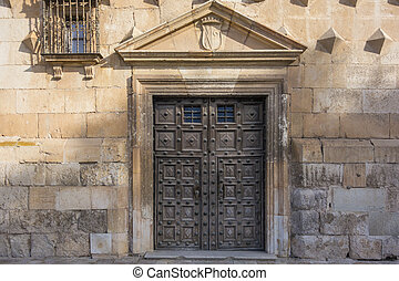 Ancient wooden door of the Palace of Dukes of Infantry in...