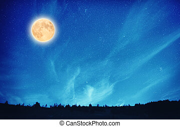 Full moon at night on the dark blue sky with many stars and...