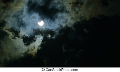 The eclipse of the sun in the sky. The eclipse through the...