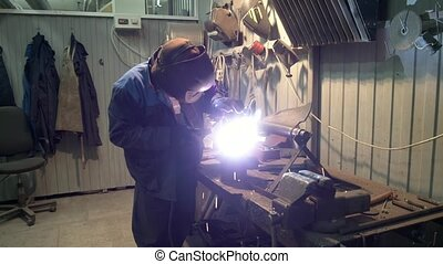 The job of a welder at a manufacturing plant