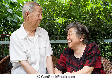 a senior couple look at each other - a senior couple soulful...
