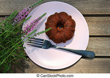Small banana bread Bundt cakes on a wooden background with copy space