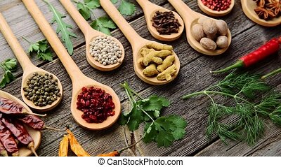 Spices and fresh herbs on a wooden table
