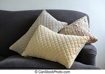 Cushions - Selection of different cushions on a grey couch