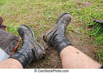 Worn Muddy Boots