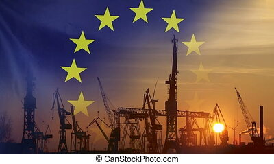 Industrial concept with EU flag at sunset, silhouette of...