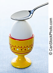Boiled egg in cup
