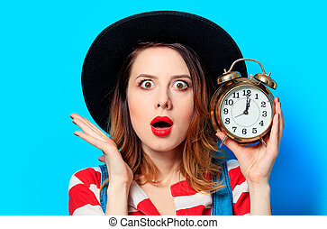 Woman with alarm clock - Portrait of young suprised...
