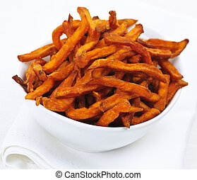 Sweet potato fries - Closeup of sweet potato or yam fries in...