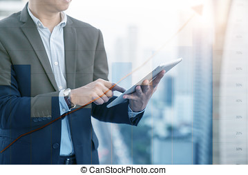 businessman using the tablet with citys