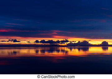 Beautiful lake after sunset with clouds. - Beautiful deep...