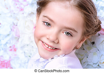 happy childhood concept - Portrait of a cute smiling girl...