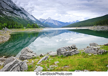 Mountain lake in Jasper National Park - Mountains reflecting...