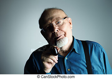 old man smoking a pipe - Portrait of a smiling old man...
