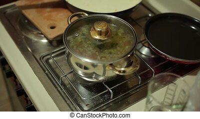 Soup in a pot on the stove. Cooking food. Boil soup.