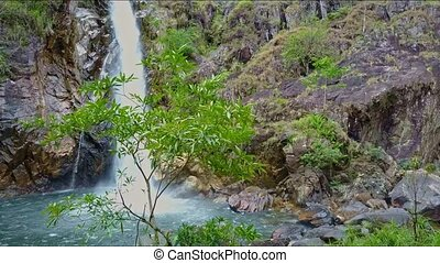 Aerial View Waterfall Runs to Lake with Tree on Foreground -...