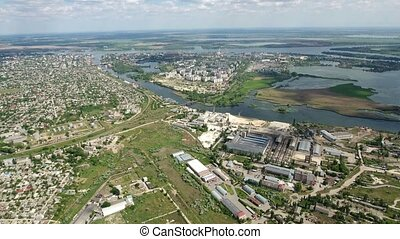 Aerial shot of Kherson outskirts and the Dnipro river bank in late spring