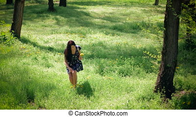 Woman gathering flowers - Beautiful girl in the field,...