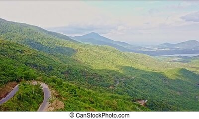 Aerial View of Green Highland Valley with Curve in Road -...