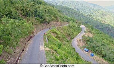 Drone Flies over Highland with Curvie Road among Jungles -...