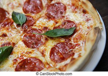 peperoni pizza on wood