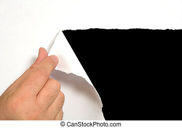 Torn paper - Torn white paper with black background