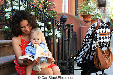 Mother with child reading a book