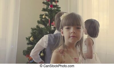 Group of children decorating christmas tree. 4K
