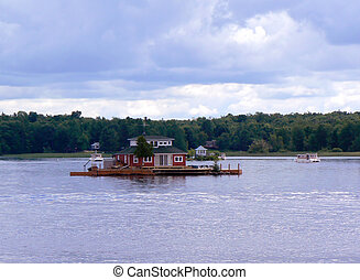Islands and red house on Ontario lake, Canada