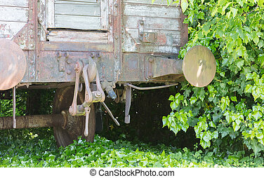 Carriage used for people transport during WW2, rusted and...
