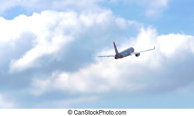 The plane took off at the airport and flies far into the...