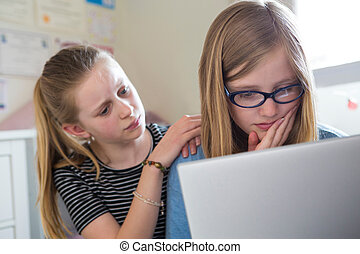 Pre Teen Girl With Friend Being Bullied On Line