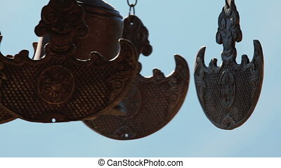 Buddhist bells fluttering in the wind against blue sky....