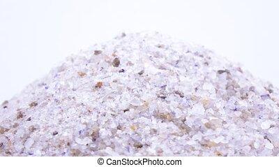Sea salt in bulk rotation - Rotation of sea salt with...