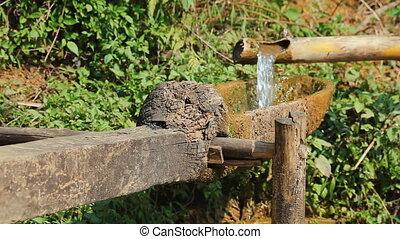 Original bamboo aqueduct used at rice terraces in Sa Pa,...