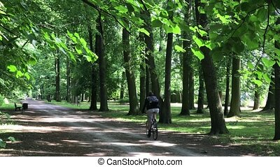 Young man riding on his bike In the park - Young man riding...
