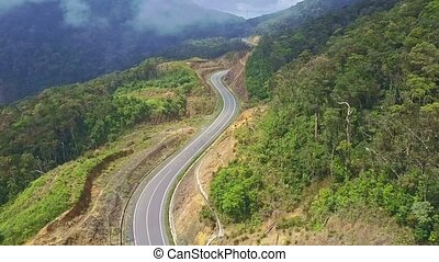 Camera Moves over Empty Modern Winding Highway on Mountain -...