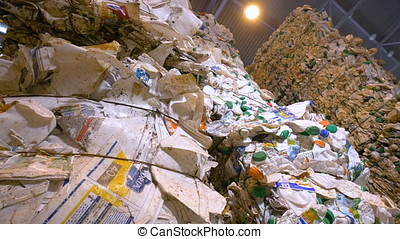 Plastic trash pressed and tied up compactly. - Plastic waste...