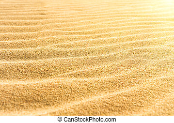 Sand texture on the beach with shining sun as natural...
