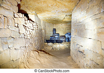 Tunnel in stone quarry mine with barrels and brick walls