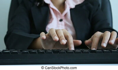 Hands of woman typing on the keyboard and using mouse with...