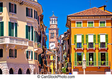 Verona colorful street and Lamberti tower view, tourist...